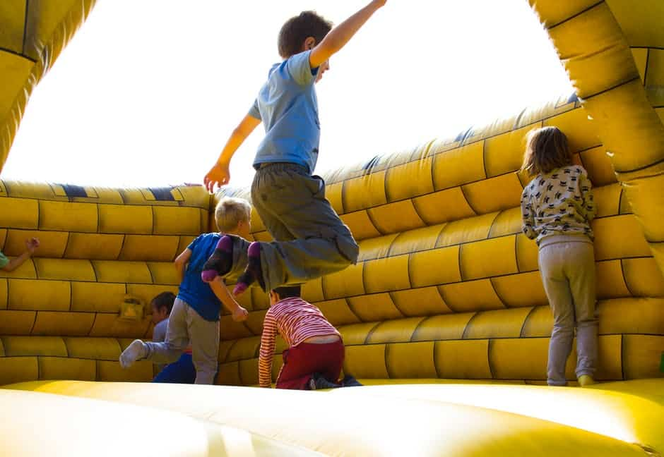 kids having fun in jumping castle